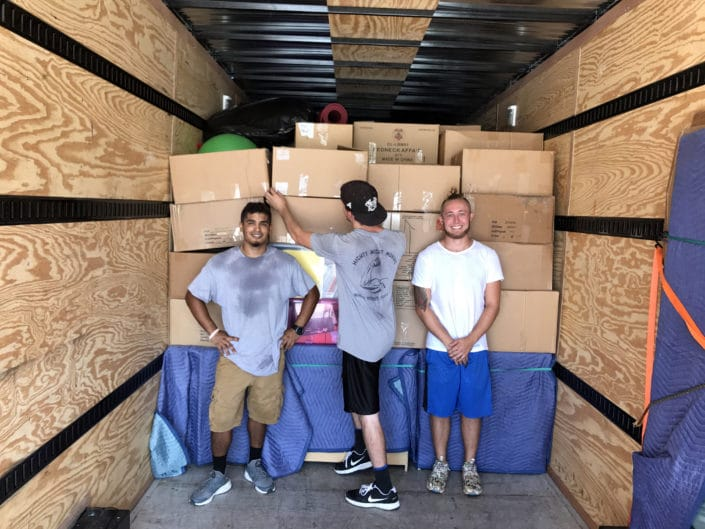 Image of Mighty Might movers in truck
