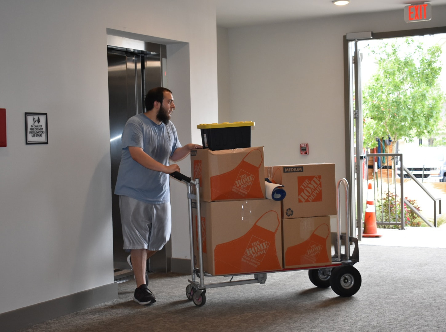 This image shows a Mighty Might mover unloading a commercial office.