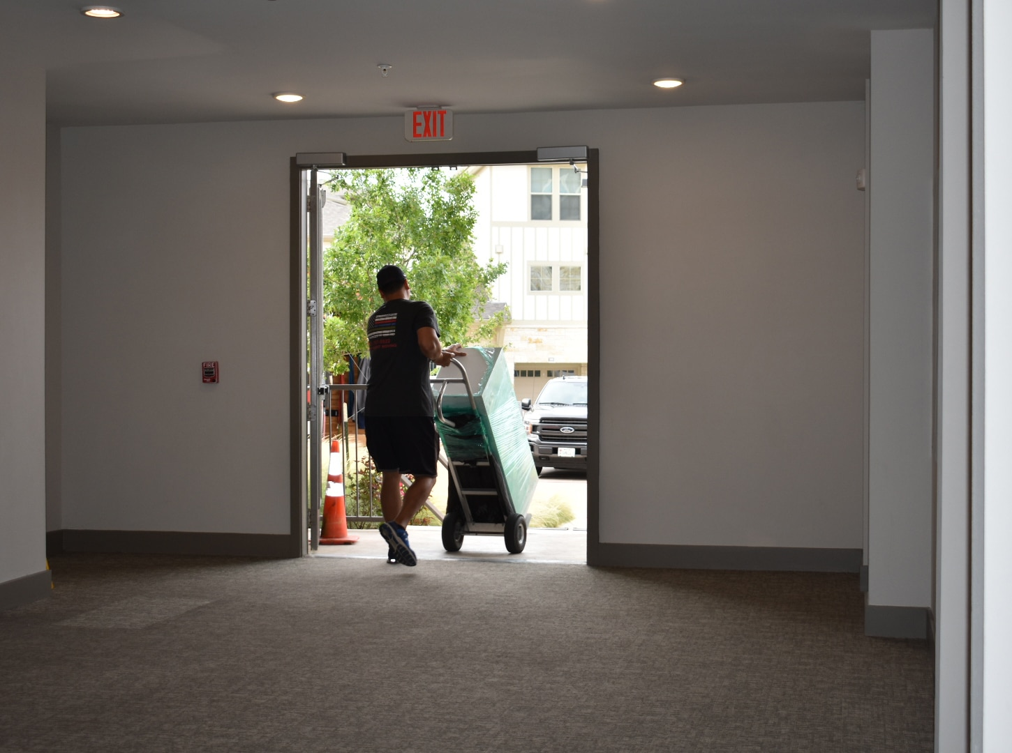 Pictured: a Mighty Might mover unloading a commercial office.