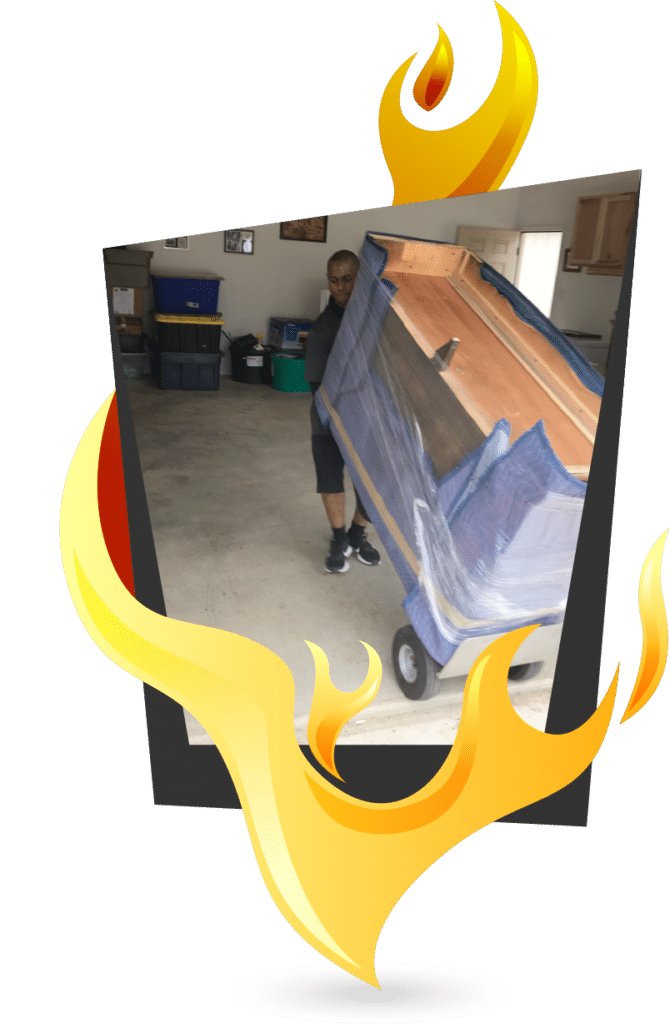 This image shows a Mighty Might mover pushing furniture for a storage unit move.